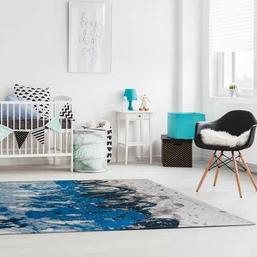 Flot tæppe i blå nuancer i børneværelse